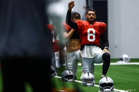 Raiders quarterback Marcus Mariota stretches during training camp at Raiders Headquarters/Inter ...