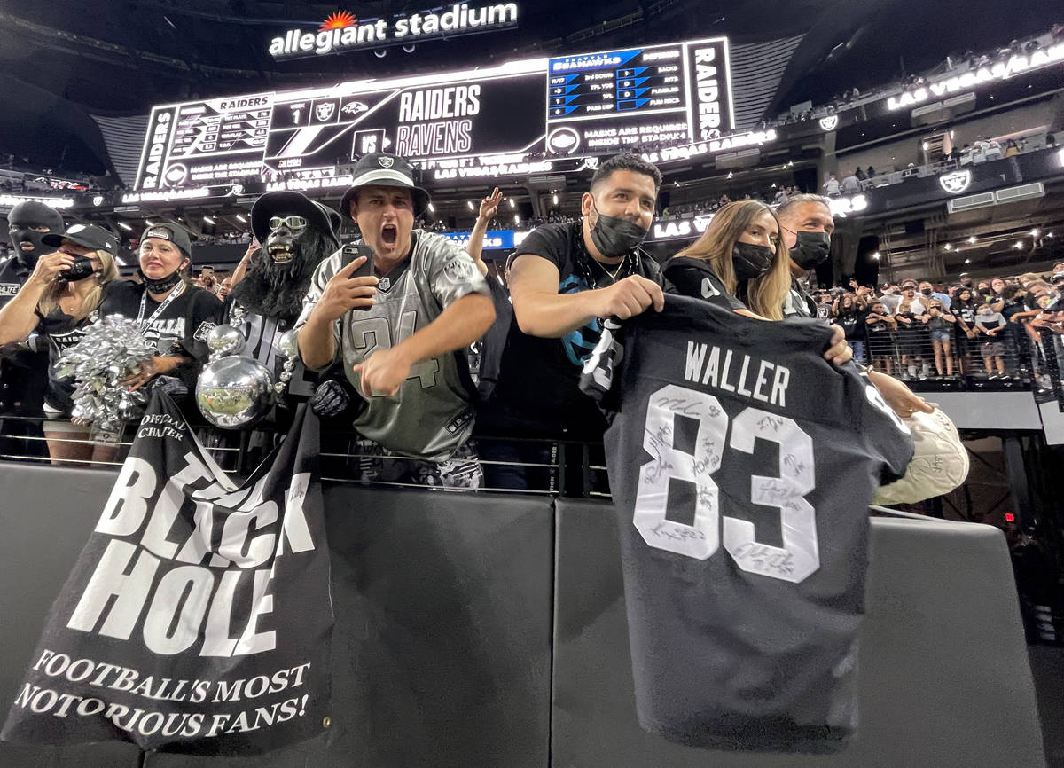 Fans cheer the Raiders at the end of a home opening pre-season NFL football game versus the Sea ...