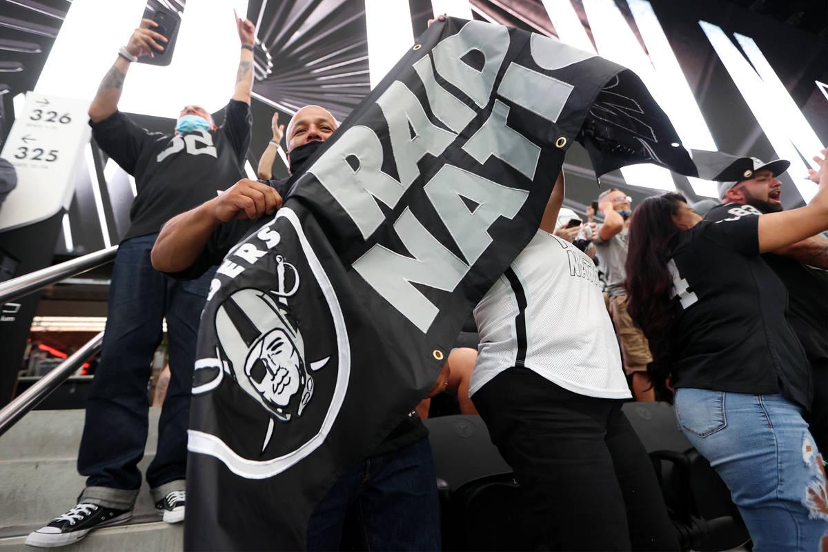 Rafael Villagrana celebrates a Las Vegas Raiders touchdown against the Seattle Seahawks in the ...