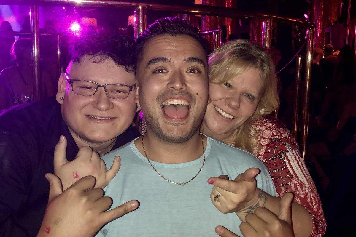 Micheal Limon, left, celebrates his 21st birthday with uncle Kary Nguyen and mother Sherry Limo ...