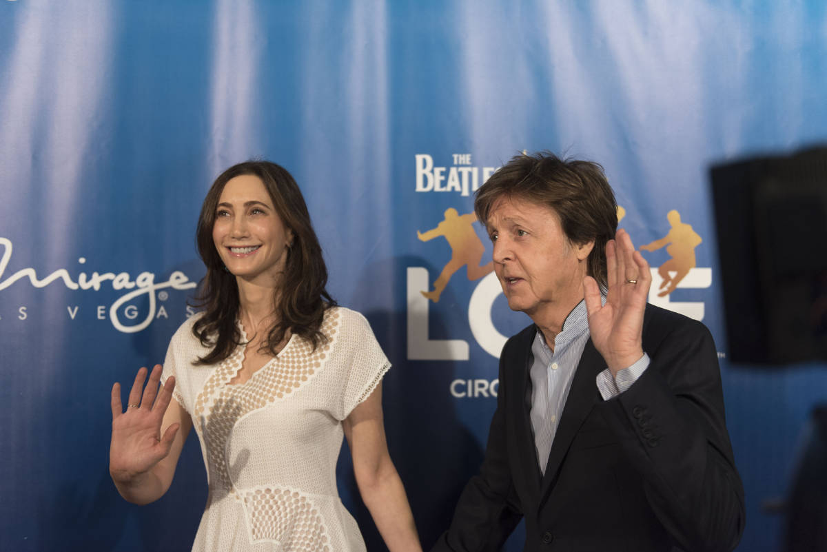 Paul McCartney, right, and his wife Nancy Shevell pose during a red carpet event to celebrate t ...