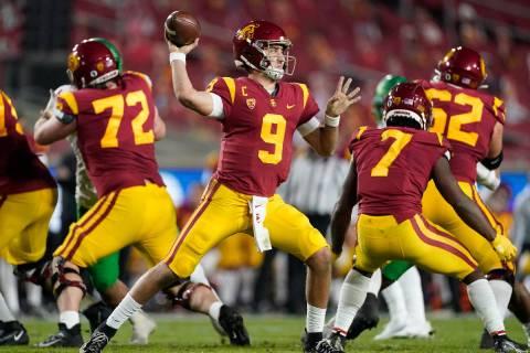 FILE - In this Dec 18, 2020, file photo, Southern California quarterback Kedon Slovis (9) throw ...