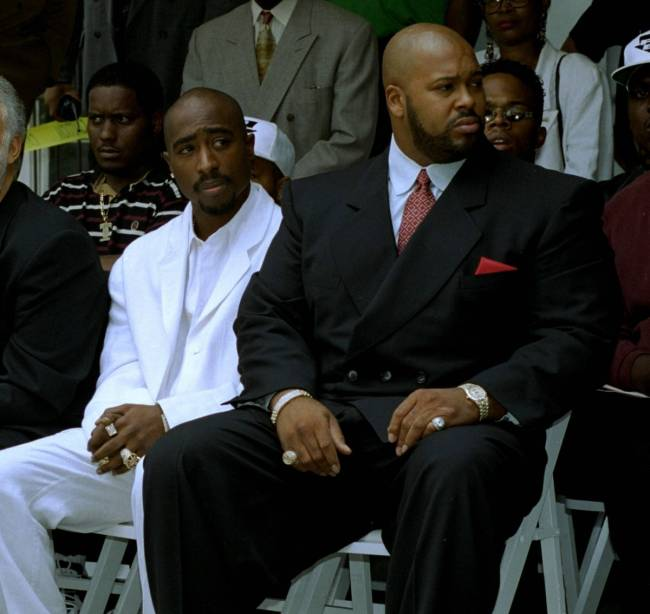 Rapper Tupac Shakur, left, and Death Row Records chair Suge Knight attend a voter registration ...