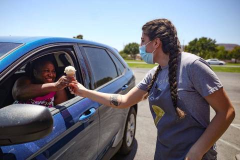Gabrielle Holloway hands an ice cream to Kerry Nixon outside her family's Baskin Robbins in Hen ...