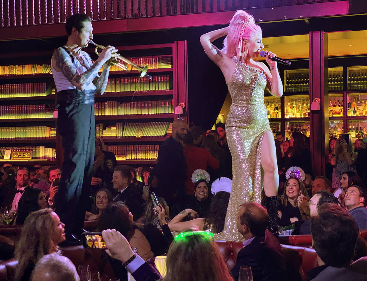 Brian Newman and Lady Gaga, perform at NoMad Restaurant at Park MGM on the Strip on New Year's ...