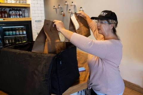 Michelle English, a delivery driver for Loco Co-Op, loads customers orders into insulated deliv ...