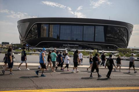 Fans make their way to Allegiant Stadium before the start of an NFL preseason football game bet ...