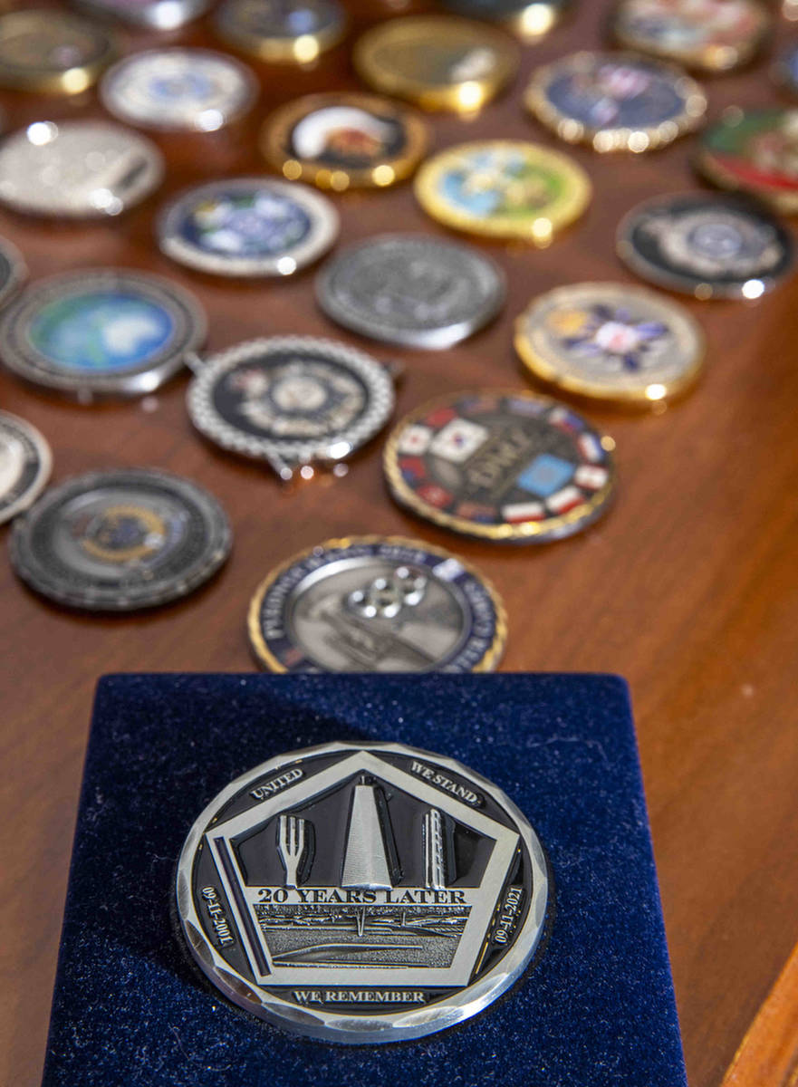 A special 9/11 coin marking the 20th anniversary of the terrorist attacks as seen in the office ...