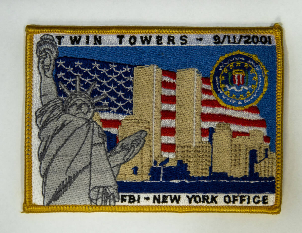 A memorial patch given to FBI Special Agent Tracy Dockery while working to sort 9/11 debris fro ...