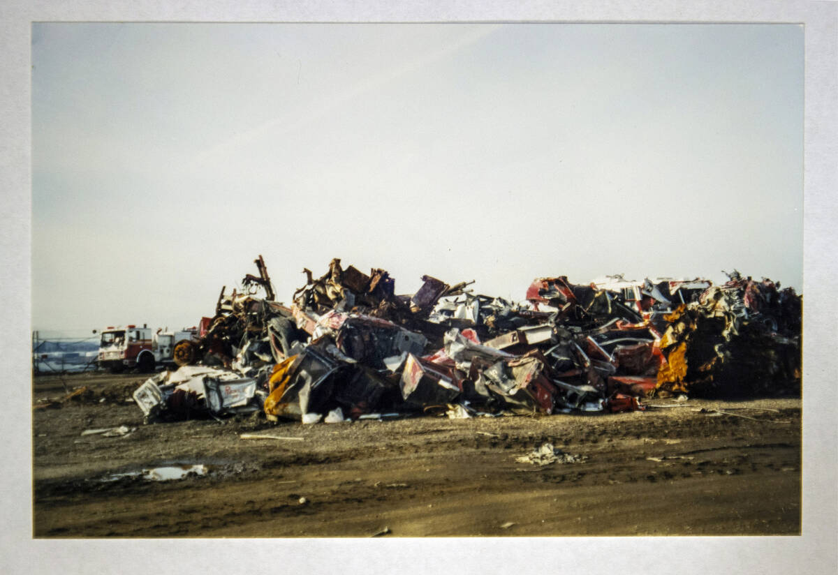 A stack of damaged cars and other metal taken by FBI Special Agent Tracy Dockery while working ...