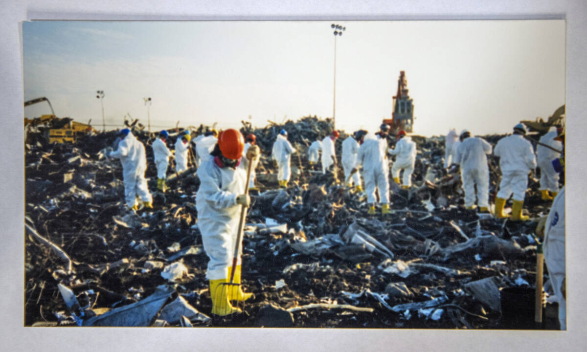 An image taken by FBI Special Agent Tracy Dockery shows people while working to sort 9/11 debri ...