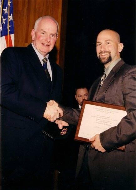 J.T. Stevens, right, at his 2003 graduation from the criminal investigator training program und ...