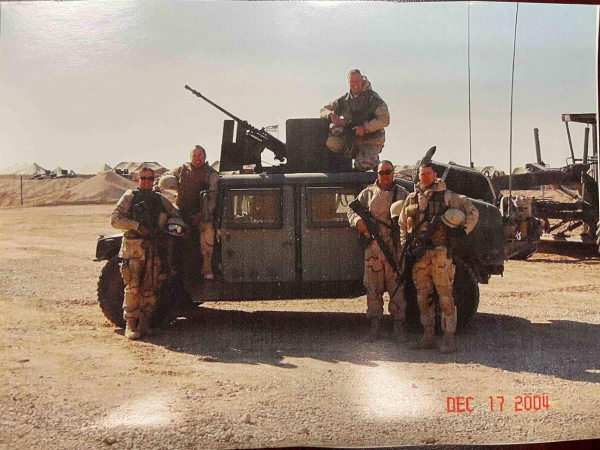 Jeb Bozarth, top center, poses with his U.S. Navy comrades. Bozarth was part of a team that pro ...