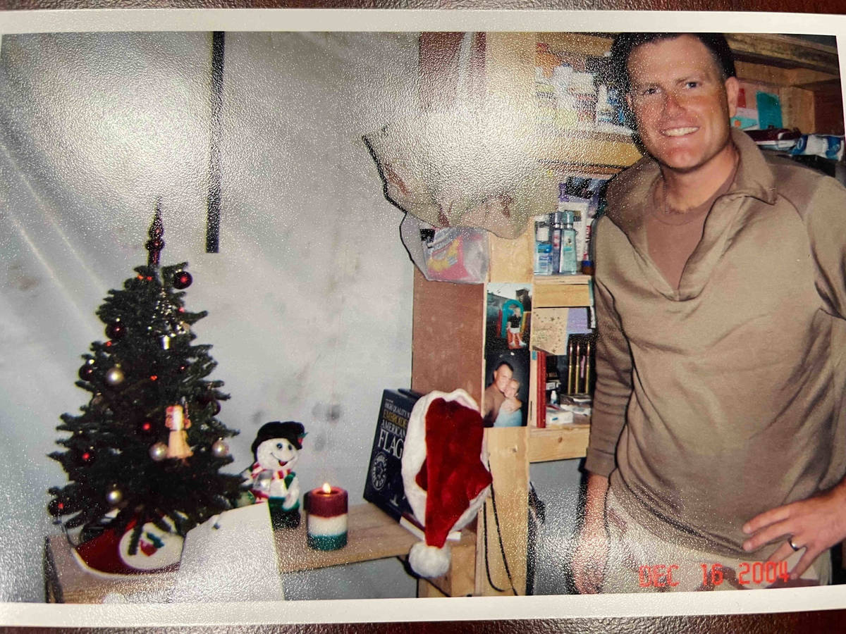 Jeb Bozarth, now a Henderson police sergeant, is pictured in Iraq during the holidays while on ...