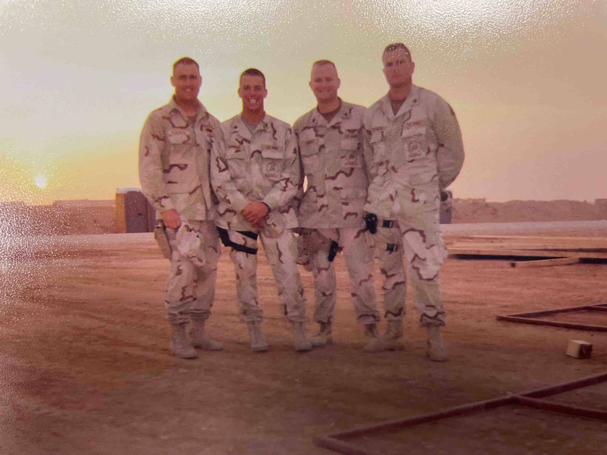 Jeb Bozarth, now a Henderson police sergeant, is pictured on the far right during sunset in Ira ...