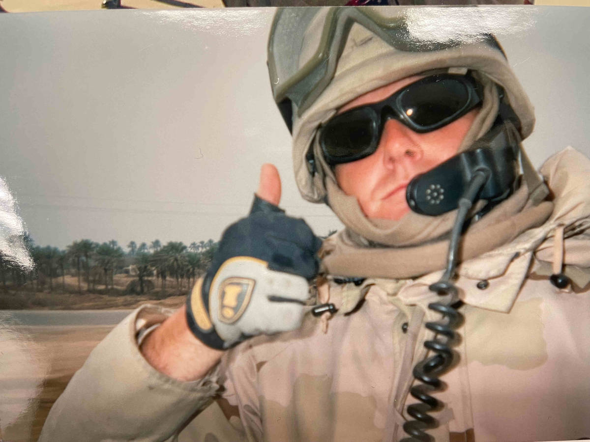 Henderson police Sgt. Jeb Bozarth is pictured in his U.S. Navy uniform during a 2004 deployment ...