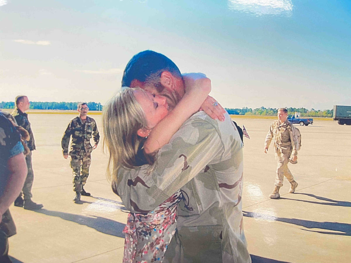 Henderson police Sgt. Jeb Bozarth is reunited with his wife after a 2004 deployment to Iraq (Je ...