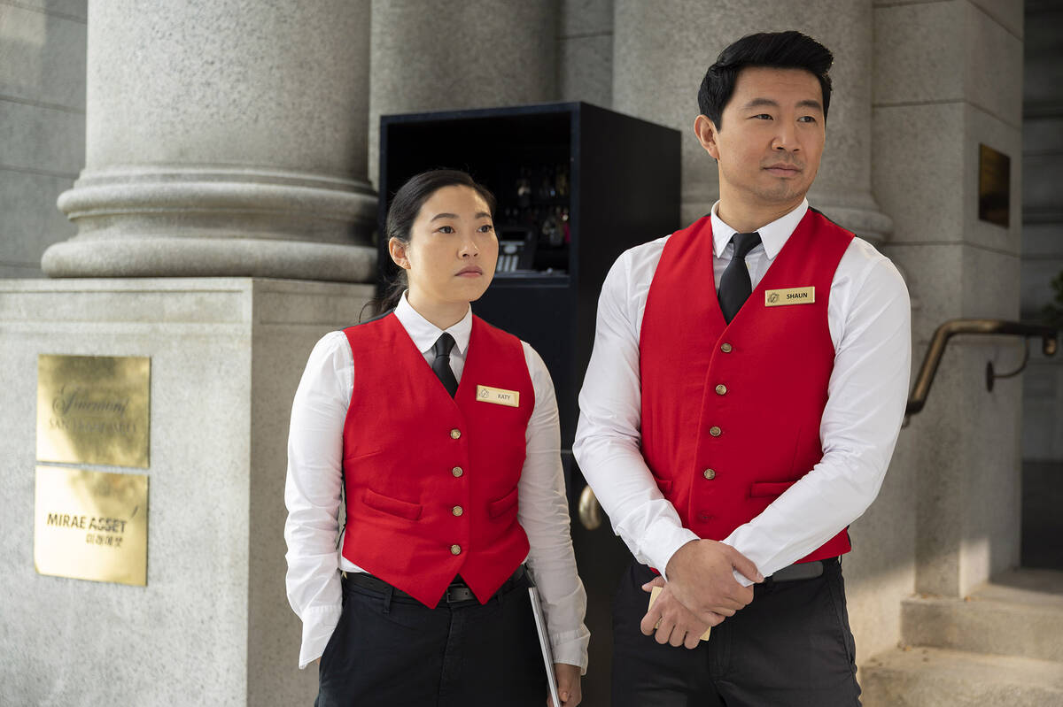 (L-R): Katy (Awkwafina) and Shang-Chi (Simu Liu) in Marvel Studios' SHANG-CHI AND THE LEGEND OF ...