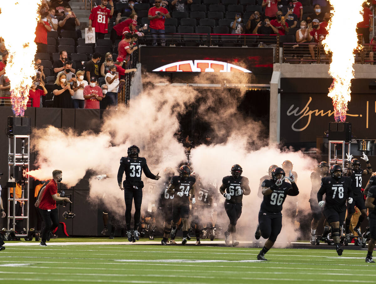 UNLV Rebels players take the field to face Eastern Washington University during their NCAA foot ...