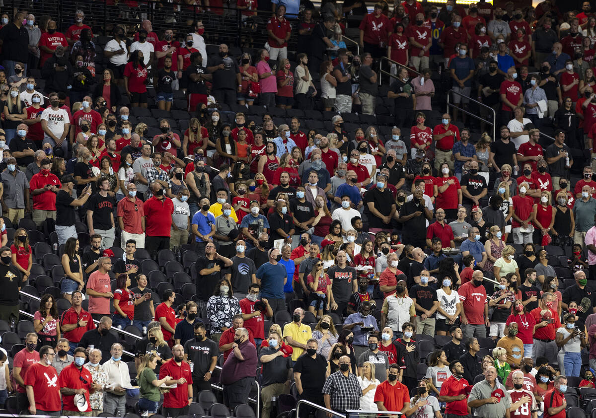Fans stand during the National Anthem before an NCAA football game between UNLV Rebels and East ...