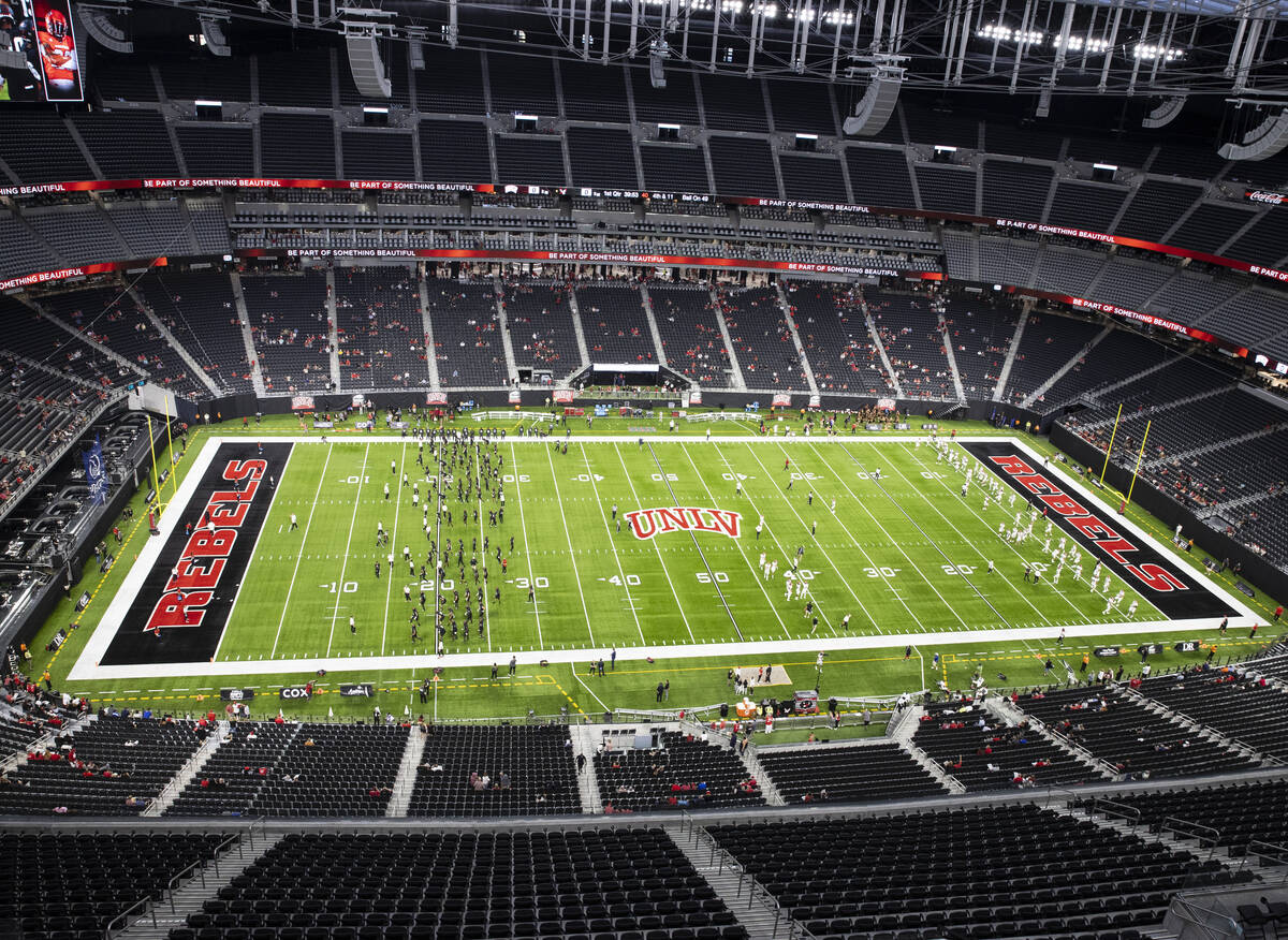 UNLV Rebels and Eastern Washington University players warm up before an NCAA football game at A ...