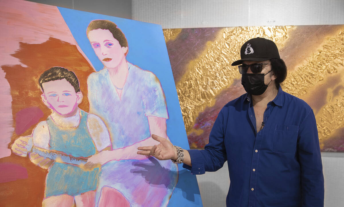 Kiss frontman Gene Simmons discusses one of his painting at Animazing on Friday, Aug. 6, 2021, ...