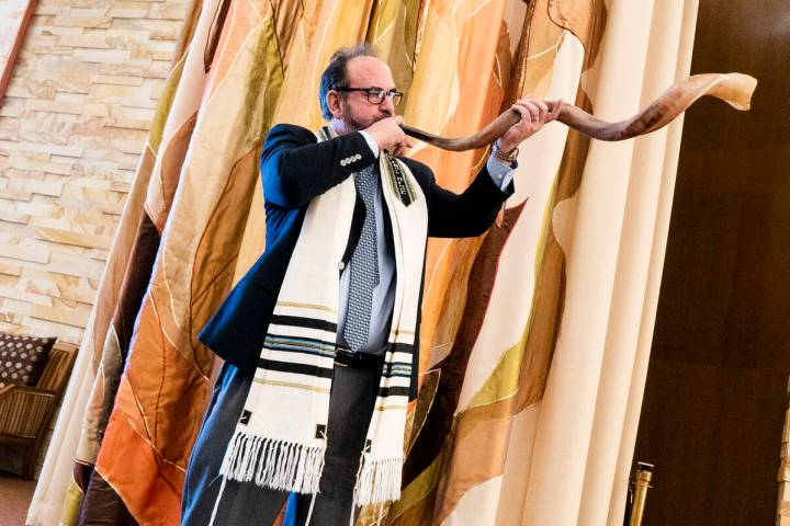 In a 2018 photo, Rabbi Sanford Akselrad of Congregation Ner Tamid sounds the shofar, which is u ...