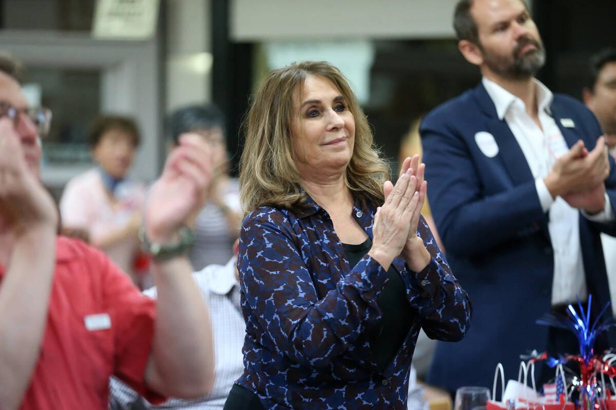 Las Vegas Councilwoman Victoria Seaman claps during a Republican National Convention watch part ...