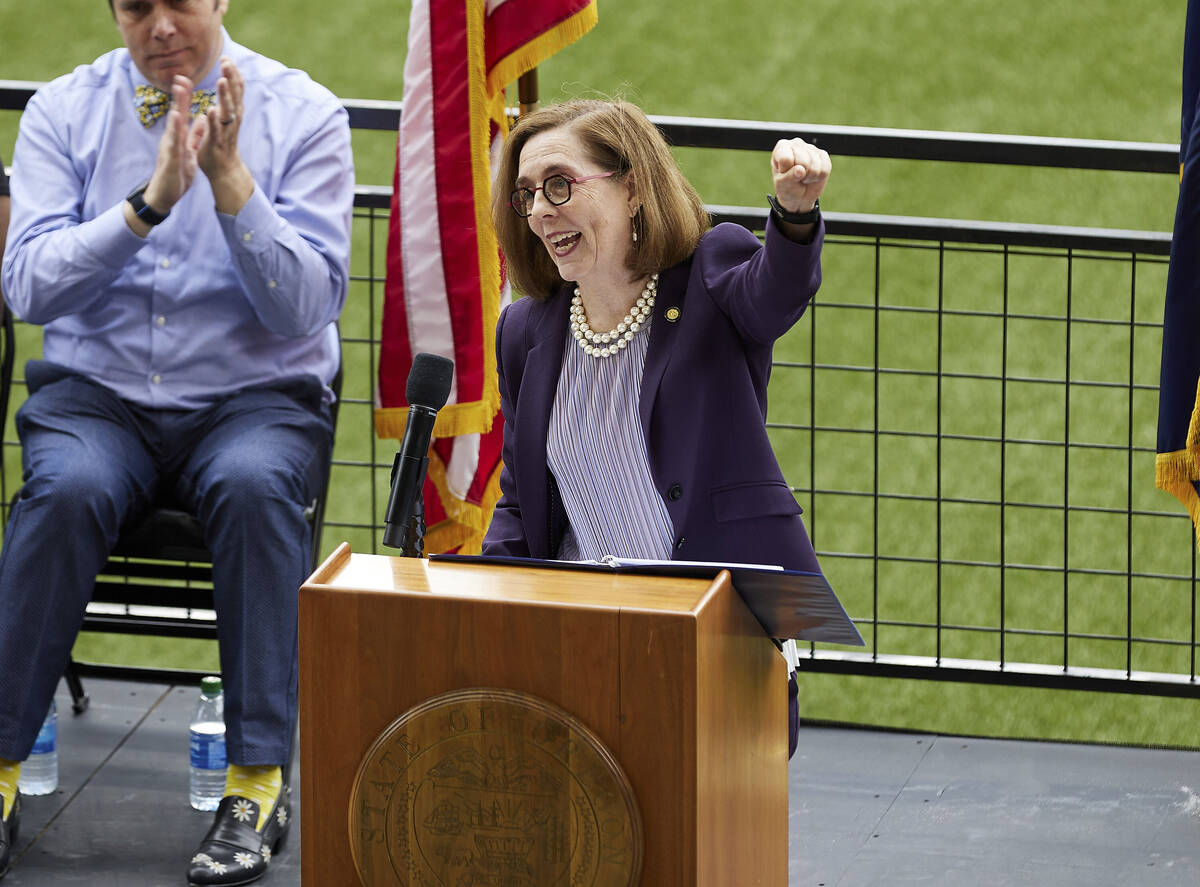 FILE - In this Wednesday, June 30, 2021, file photo, Oregon Gov. Kate Brown pumps her fist whil ...