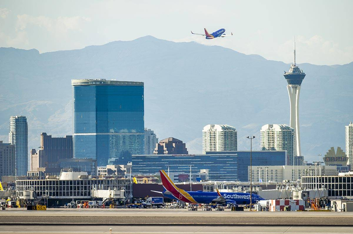 A Southwest plane departs as heat is causing travel delays at McCarran International Airport on ...