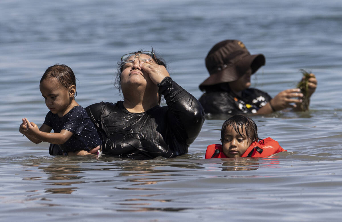 People try and stay cool in Lake Mead on Labor Day on Monday, Sept. 6, 2021, in Boulder City. ( ...
