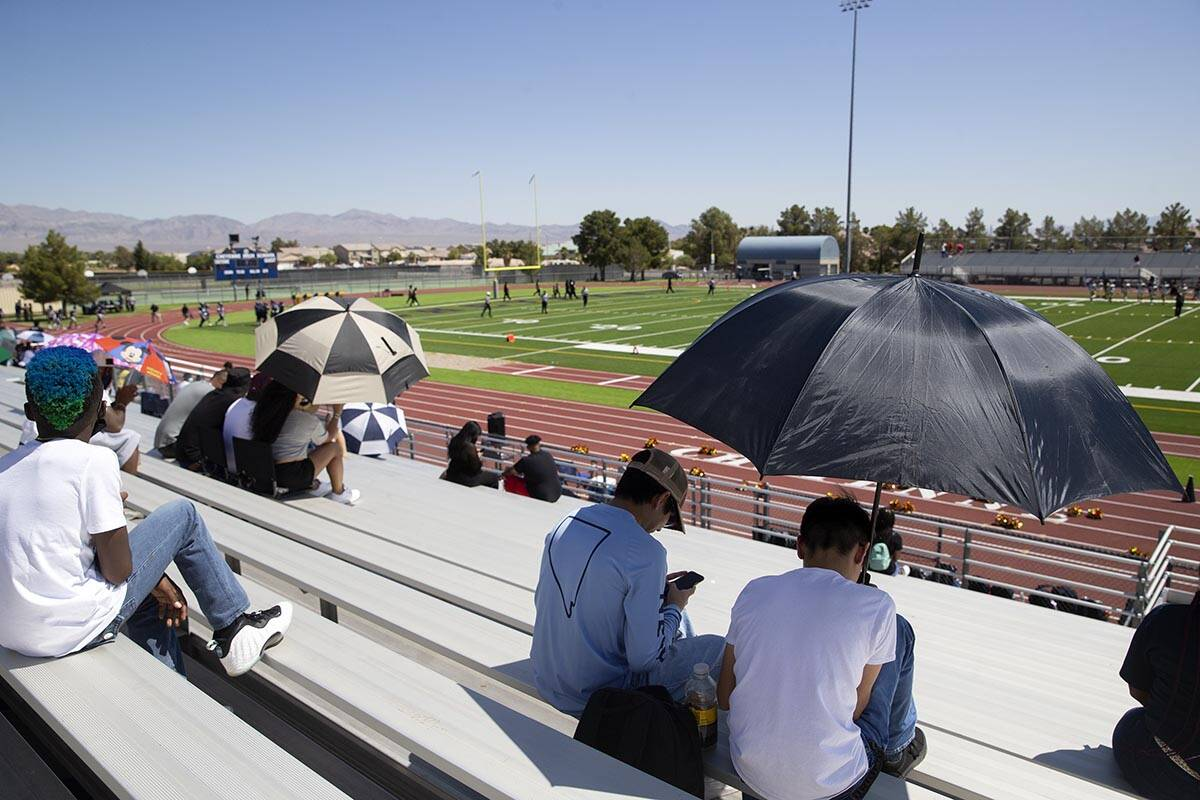 Fans attempt to stay cool during a football game between Clark High School and Cheyenne High Sc ...
