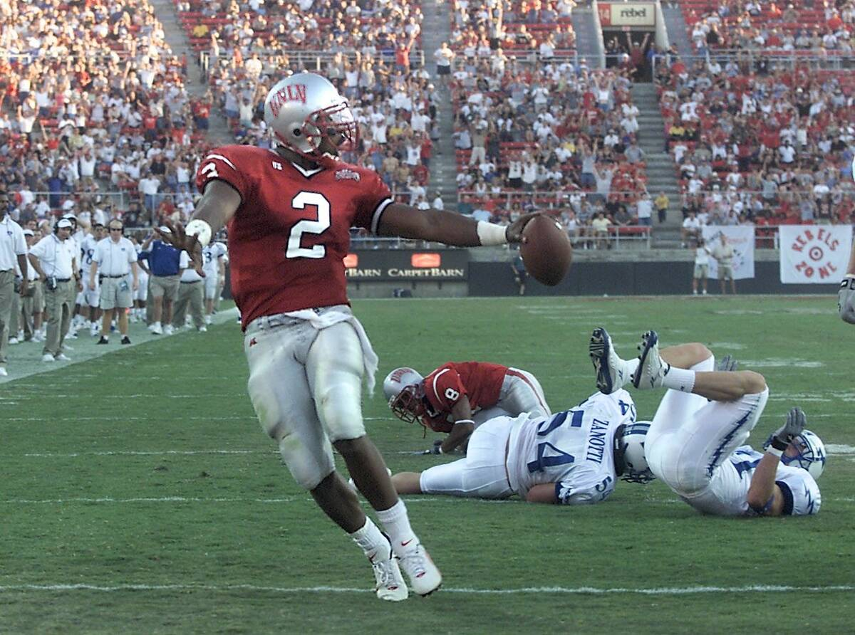 Sports;09-30-00, UNLV quarterback Jason Thomas runs into the end zone for a touchdown against ...