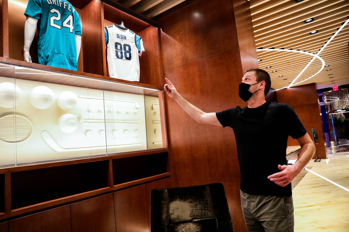 Kevin Jones, CEO of Blue Wire, points out jerseys on display at the Blue Wire Studios at Wynn L ...
