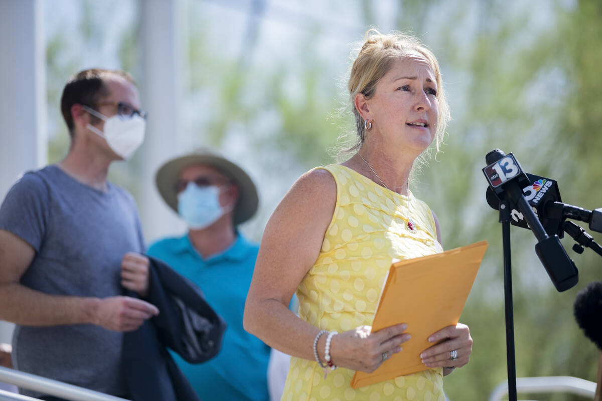 """Molly Taylor, organizer of the """"Expel Michele"""" recall effort, speaks during a news conference o ..."""
