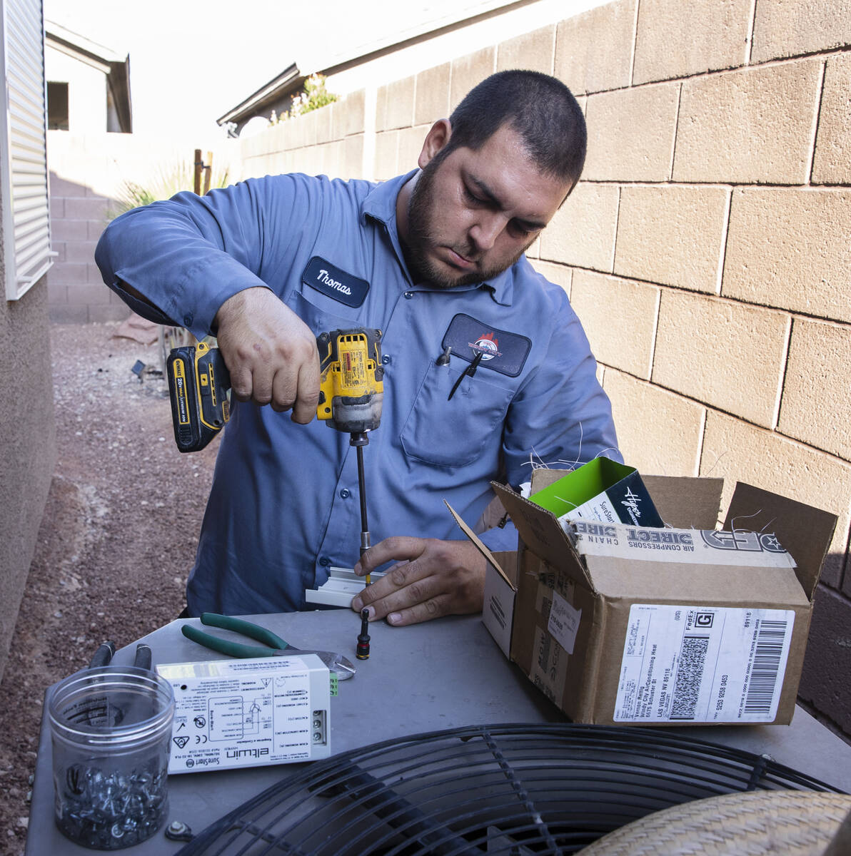 Windy City Air's technician Thomas Padron repairs an air conditioner at Vulcan St on Friday, Se ...