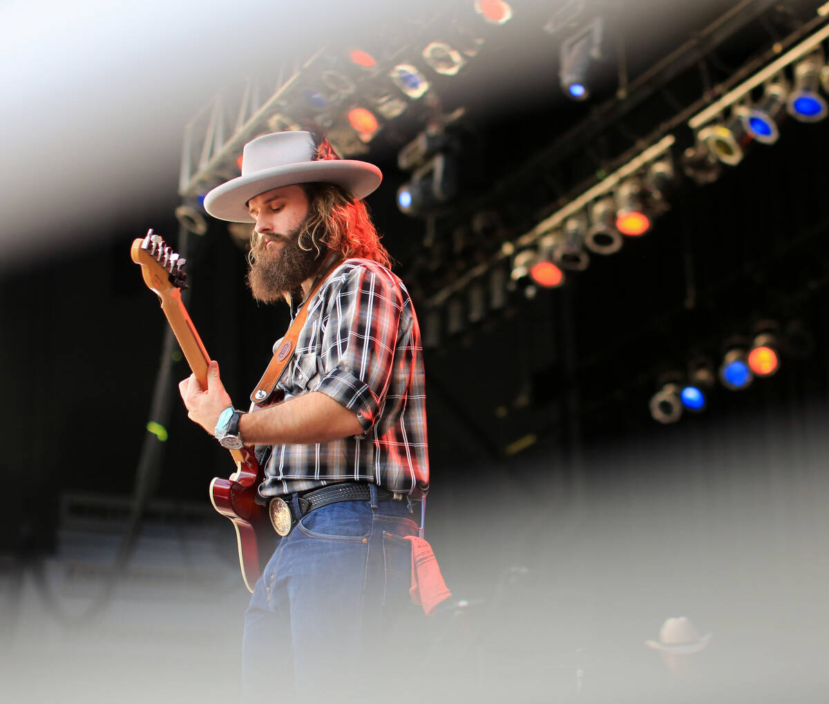 Chase Nutter plays lead guitar with The Rhyolite Sound at the Country 58 Benefit Concert, to he ...
