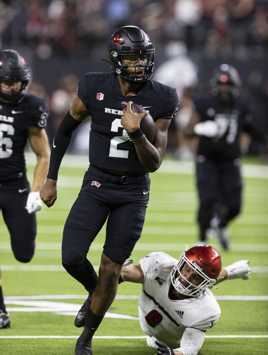 UNLV Rebels quarterback Doug Brumfield (2) goes for a touchdown during the fourth quarter of an ...