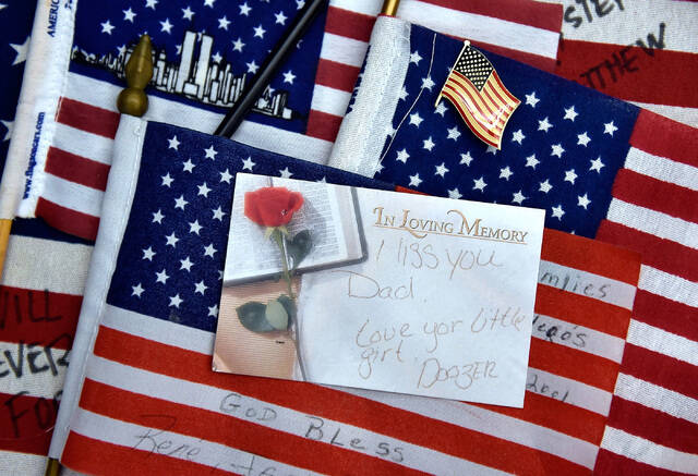 American flags and a personalized note card, gathered from the New York-New York's 9/11 heroes ...