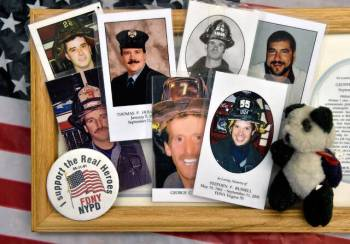 Memorial mass cards with photographs of fallen firefighters, collected from New York-New York's ...
