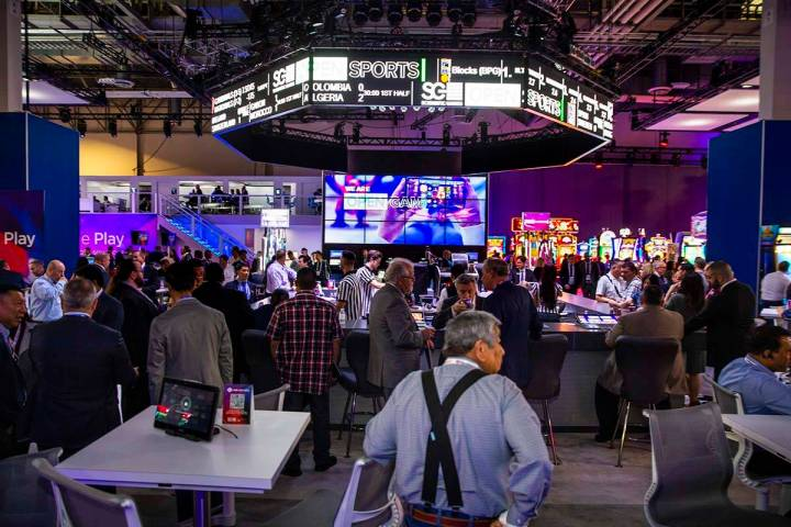 The bar is in full swing within the Scientific Games Corporation exhibition space during the Gl ...