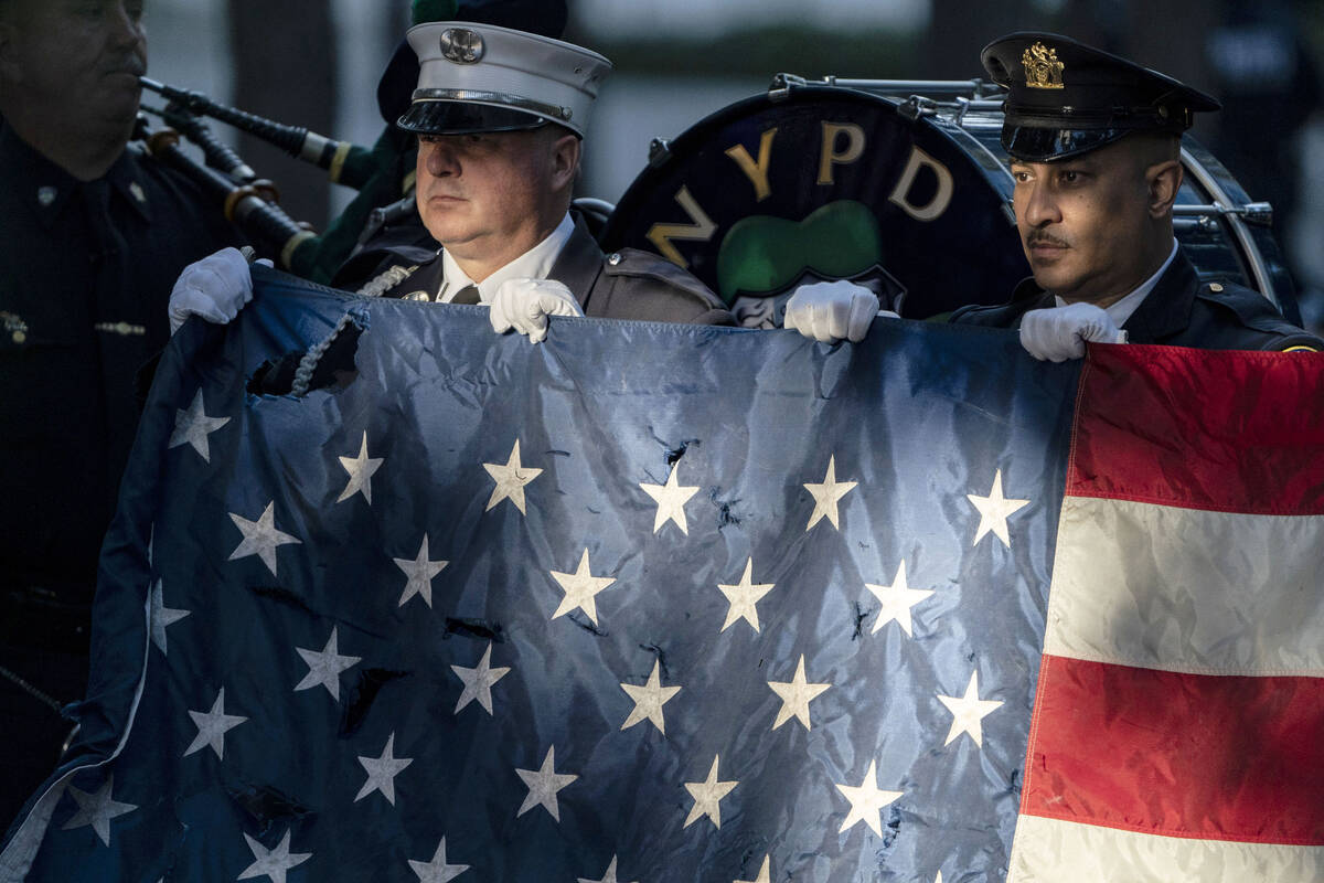 Flag bearers rehearse before ceremonies to commemorate the 20th anniversary of the Sept. 11 ter ...