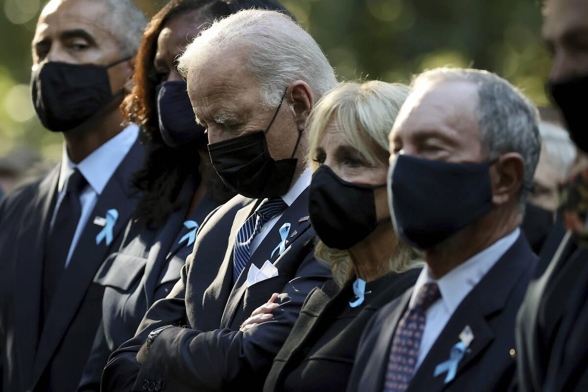 From left, former President Barack Obama, Michelle Obama, President Joe Biden, first lady Jill ...