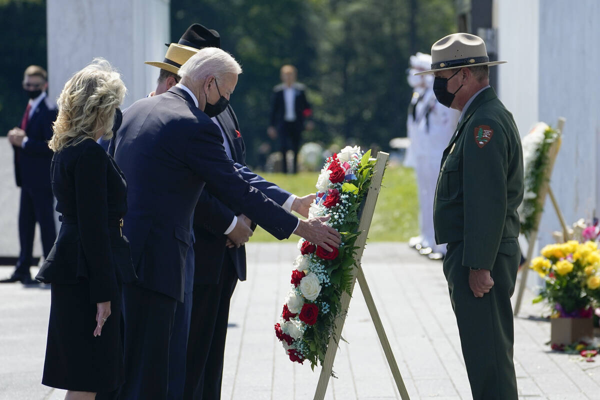 President Joe Biden and first lady Jill Biden lay a wreath at the Wall of Names during a visit ...