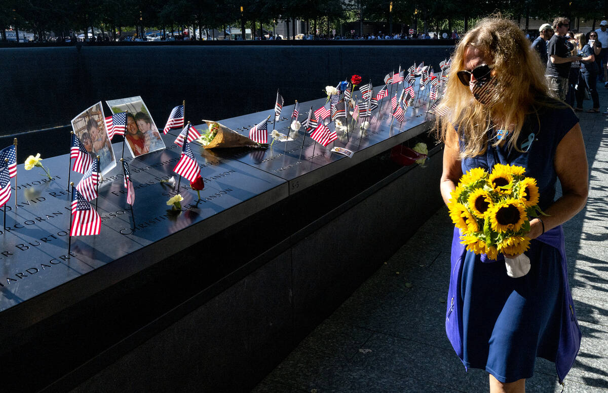 Flags adorn the inscribed names of the victims of Sept. 11, 2001, at the National September 11 ...