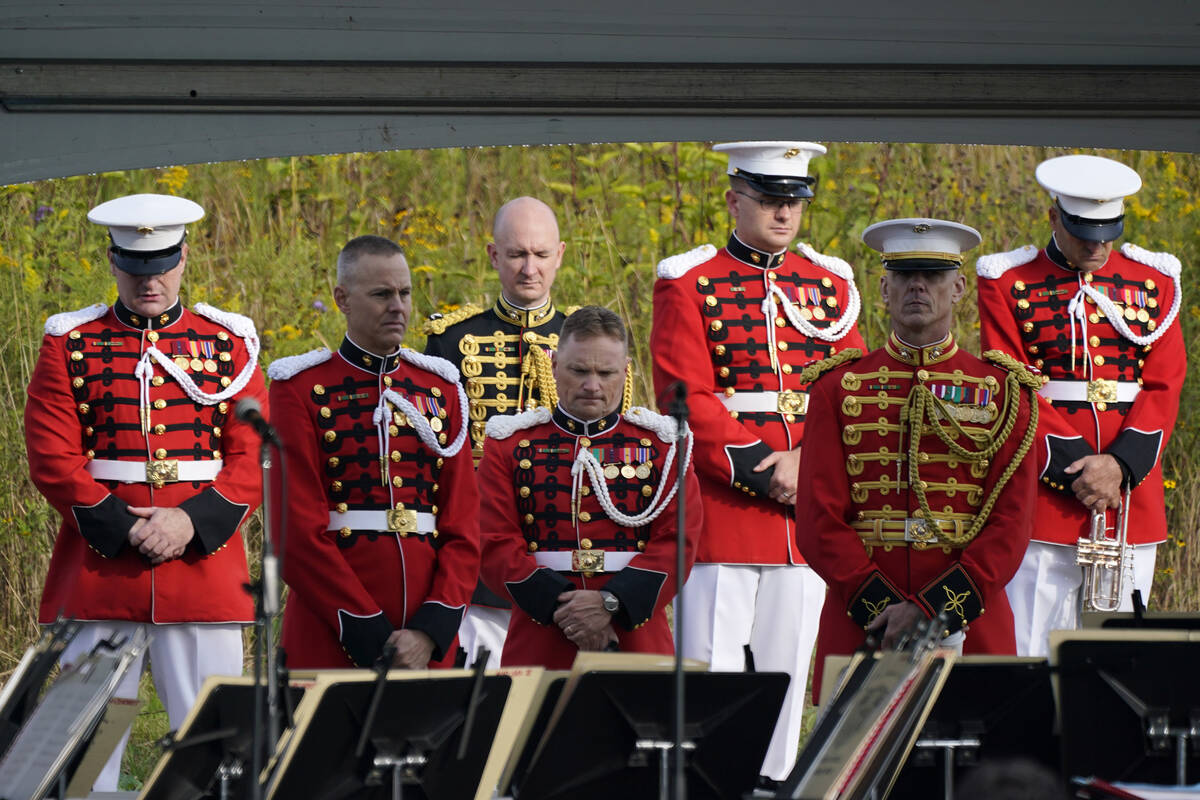 Members of the United States Marine Band observe a moment of silence before performing at the F ...