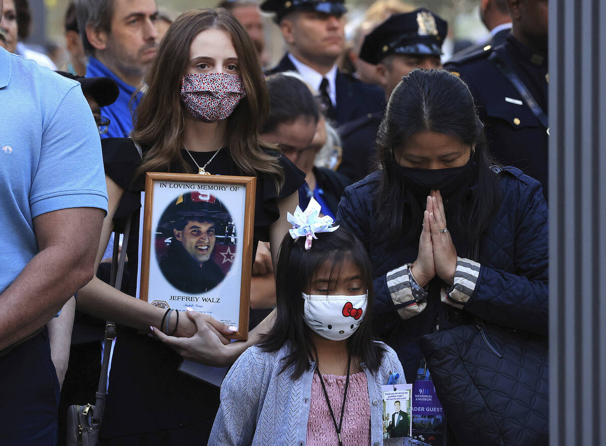Family members and loved ones of victims attend ceremonies to commemorate the 20th anniversary ...
