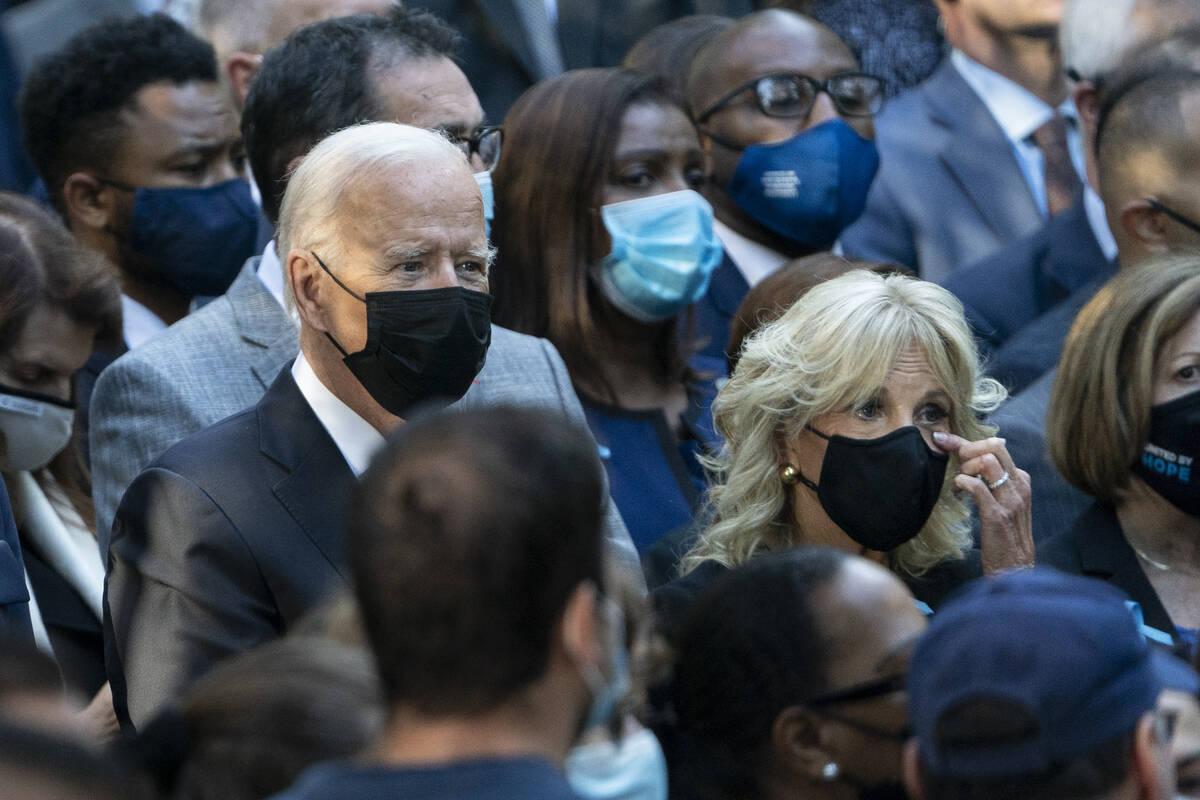 First Lady Dr. Jill Biden wipes her eyes alongside President Joe Biden during ceremonies to com ...
