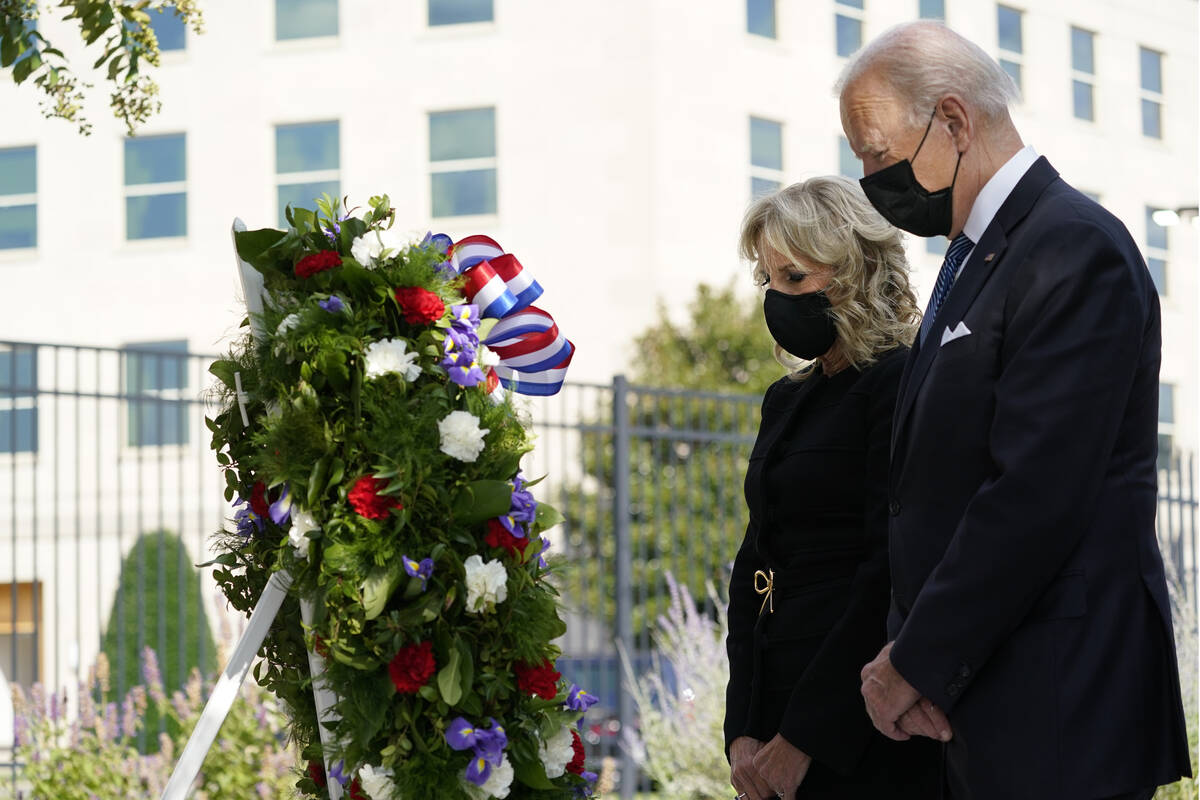 President Joe Biden and first lady Jill Biden participate in a wreath ceremony on the 20th anni ...