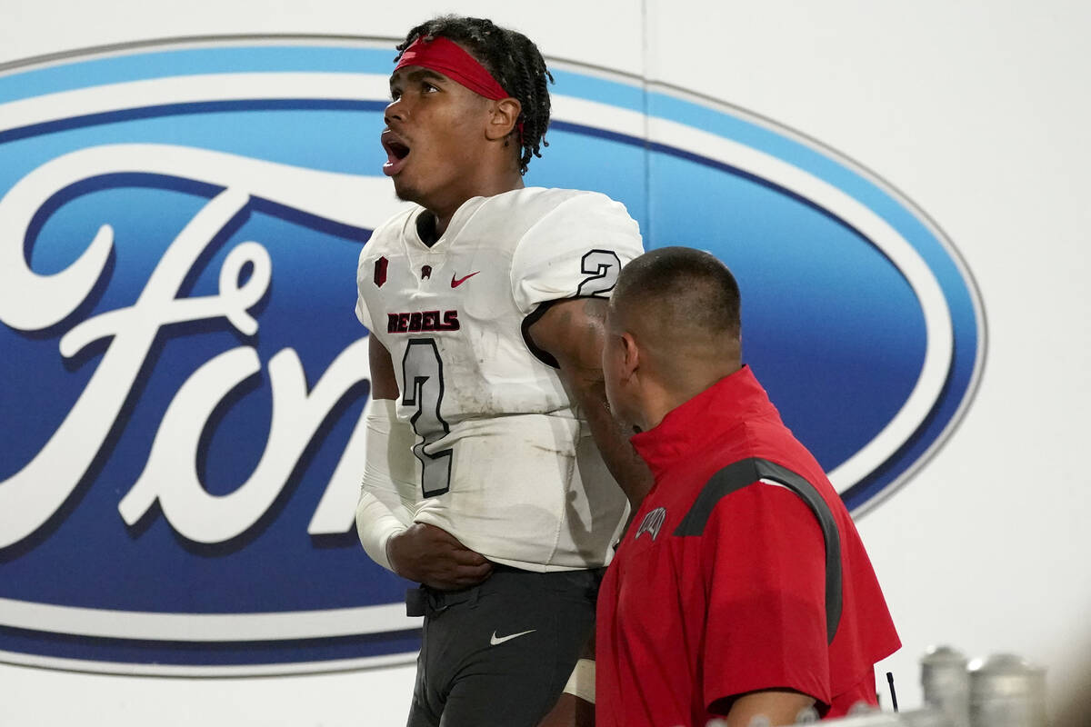 UNLV quarterback Doug Brumfield (2) leaves the game during the second half of an NCAA college f ...